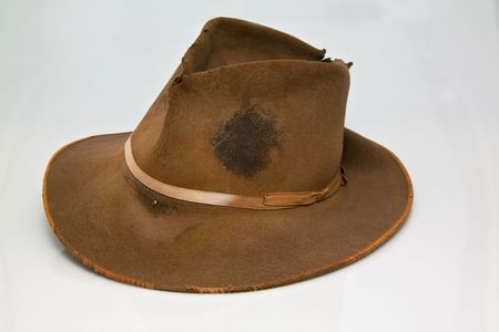 accesory: Old, worn brown hat, that is stained with sweet of hard labour Stock Photo