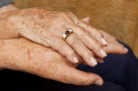 loving hands: Old couple holding hands with ring on finger
