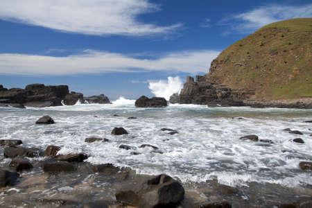Landscape of waves blue sky and rocks in sunshine photo