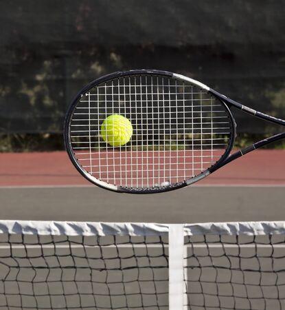 tennis racket: Raquet with tennis ball on court hit