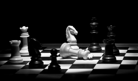 bishop chess piece: Check mate chess game in black and white