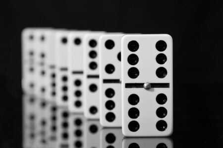 Dominoes on black shining surface with reflection Stock Photo - 10679985