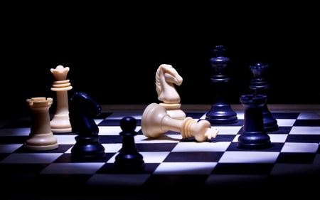 bishop chess piece: Check mate chess game in spot light Stock Photo