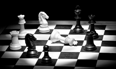 Check mate in black and white with selective lighting Stock Photo