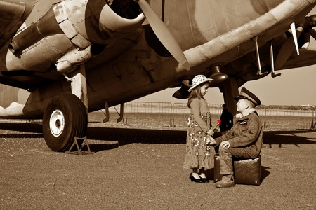 Wife saying good bye to pilot husband leaving for war photo