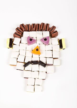 Sad face of an allsorts man build with sweets