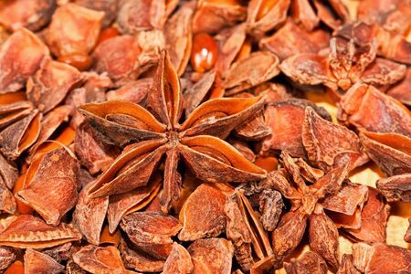 aniseed: Dry star aniseed on a brown wooden board