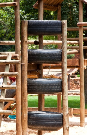 Kids jungle gym, made out of wood and tires photo