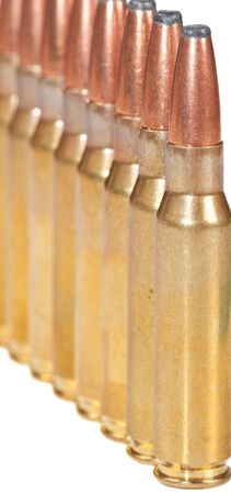 Macro of rifle bullets in a row on a white background Stock Photo - 12668602