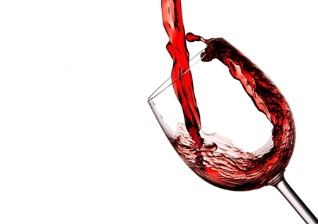 abstract liquor: Red wine poured into a crystal wine glass to make a splash