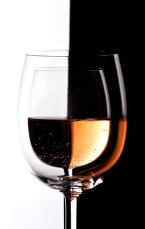 Wine glasses with contrast in color and reflections photo