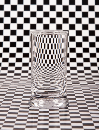 Small glass with distortion with black and white check photo