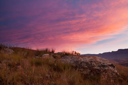 Drakensberg sunset with a rock proment in the foreground