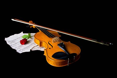 Violin sheet music and rose black composition still life music photo