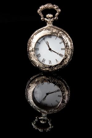 pocketwatch: Pocket watch reflection on black shiny surface detail