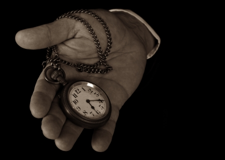 pocketwatch: Pocket watch in hand hold look time detail Stock Photo