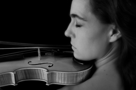 Portrait of woman with violin black and white serious concentration photo