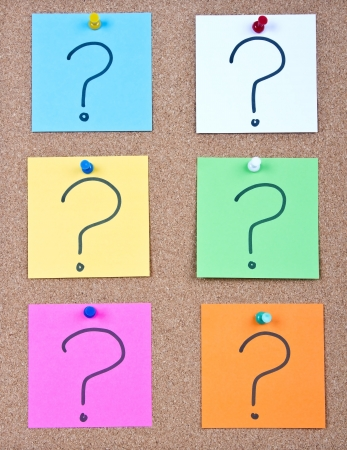 Post it notes on wood collage with question mark photo