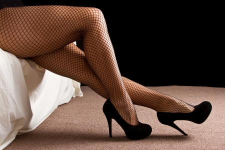sexually: Legs with black high heal shoes and fishnet stockins woman