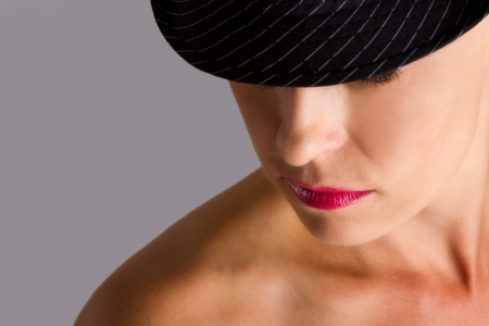 Artistic conversion woman with hat closeup emotion photo