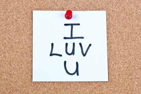 Post it note on wood in white with I love you photo