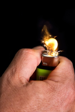 Hand with lighrt igniting close-up on dark background Stock Photo - 20452341