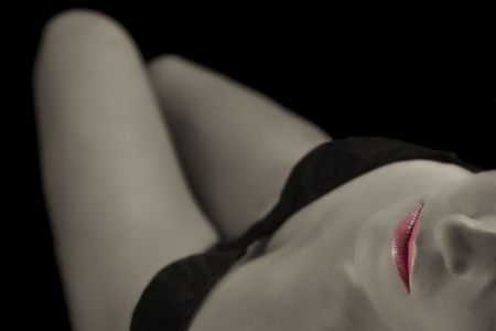 Artistic conversion woman with underwear in sepia and red lips photo
