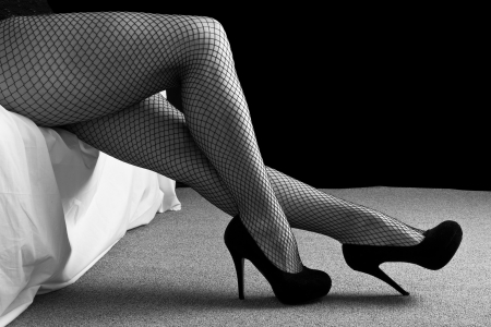 boudoir: Legs with black high heal shoes and fishnet stockins woman