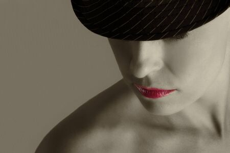 Artistic conversion woman with hat in black and white photo