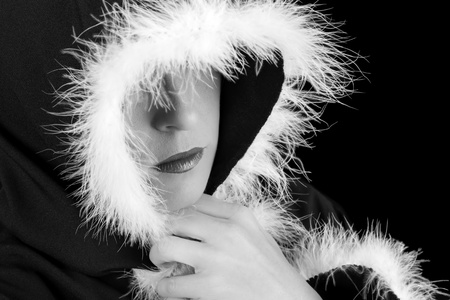 Portrait of sad woman in black cape with feather black and white photo