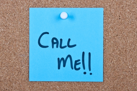 call me: Post it note blue with call me message on cork Stock Photo
