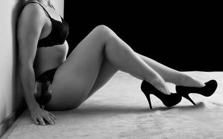Woman in black underwear sit on floor shoes photo
