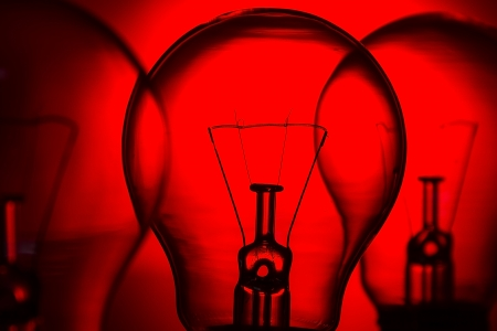 Row of light bulbs on a bright  red background with detail photo