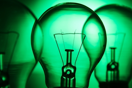 Row of light bulbs on a bright green background with detail photo