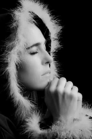 Portrait of sad woman in black cape praying feathered rim artistic conversion photo