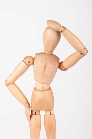 Plain wood mannequin stand upright isolated on white background holding head photo