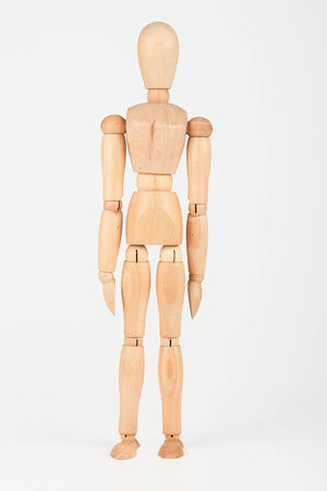 Plain wood mannequin stand upright isolated on white background photo