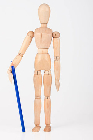 artists dummy: Small wood mannequin standing with colour pencil isolated on white background Stock Photo