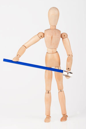 sharpen: Small wood mannequin stand sharpen colour pencil isolated