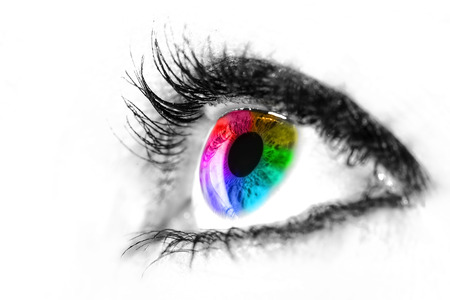 Eye macro in high key black and white with colourful rainbow in the iris photo