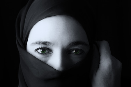 Middle Eastern woman portrait looking sad with a hijab artistic conversion photo