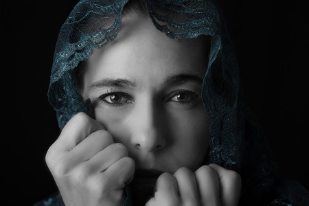 Middle Eastern woman portrait looking sad with a hijab artistic conversion