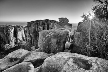desolation: Valley of Desolation in Camdeboo National Park near Graaff-Reinet landscape with rocks and sunset artistic conversion Stock Photo