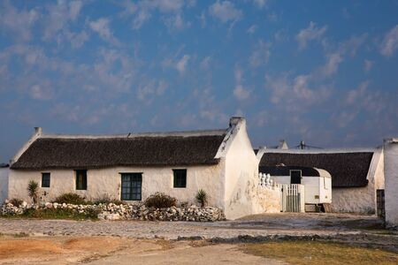residential settlement: Old white fisherman house with reed roof in Arniston, South Africa