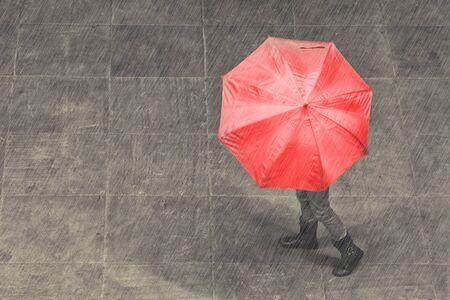 Girl walk with umbrella in rain on a pavement artistic conversion