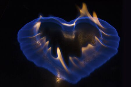 incendiary: Blue flame in the shape of a heart burning on shiny surface