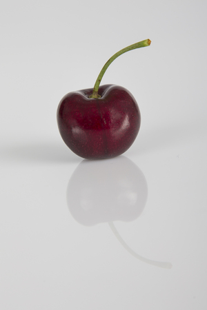 white washed: Close-up of a cherry on a white background