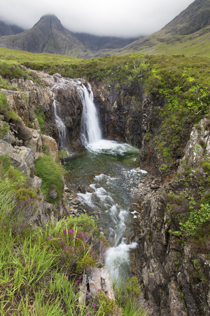 skye: Waterfall in the Fairy Pools rocky stream on Isle of Skye