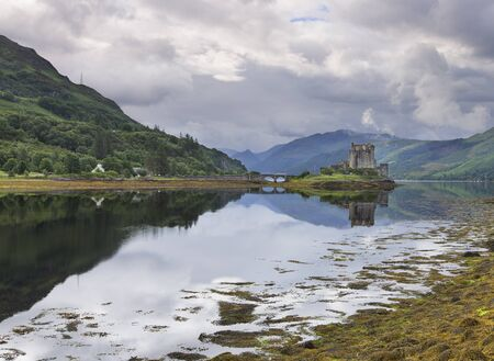 highland: Eilean Donan Castle at Dornie on Kyle of Lochalsh in Scotland with a reflection Stock Photo