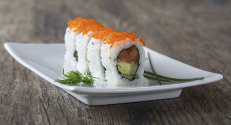 Delicious mixed sushi arranged on a white marble surface Stock Photo